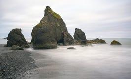 Lange Belichtung des karminroten Strandes Lizenzfreie Stockbilder