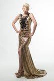 Lange de Manierkleding van de vrouwenschoonheid, Elegant Meisje in Gouden Toga Stock Foto's