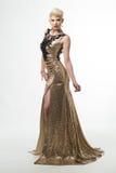 Lange de Manierkleding van de vrouwenschoonheid, Elegant Meisje in Gouden Toga Royalty-vrije Stock Foto's