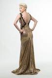Lange de Manierkleding van de vrouwenschoonheid, Elegant Meisje in Gouden Toga Stock Foto