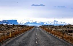 Lange harte Straße Stockbild