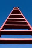 Lange Rode Ladder stock afbeelding