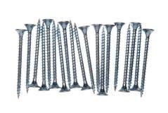 Lange Spanplattenschrauben lokalisiert Stockfotografie