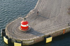 Langelinie in Copenhagen. Concrete pier or dock, with red lighthouse or signal tower,jutting out into water, Langelinie, Copenhagen, Denmark Stock Photos