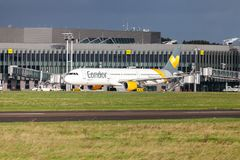 Airbus A 321 from airline Condor drives on airport to the runway. LANGENHAGEN / GERMANY - OCTOBER 28, 2017: Airbus A 321 from airline Condor drives on airport to Stock Photos