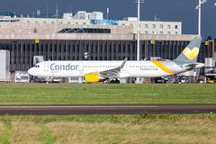 Airbus A 321 from airline Condor drives on airport to the runway. LANGENHAGEN / GERMANY - OCTOBER 28, 2017: Airbus A 321 from airline Condor drives on airport to Royalty Free Stock Photos