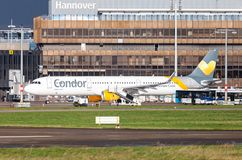 Airbus A 321 from airline Condor drives on airport to the runway. LANGENHAGEN / GERMANY - OCTOBER 28, 2017: Airbus A 321 from airline Condor drives on airport to Royalty Free Stock Photography