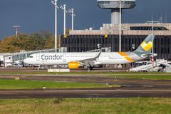 Airbus A 321 from airline Condor drives on airport to the runway. LANGENHAGEN / GERMANY - OCTOBER 28, 2017: Airbus A 321 from airline Condor drives on airport to Royalty Free Stock Image