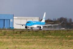 Embraer ERJ-175 from airline KLM lands on international airport. LANGENHAGEN / GERMANY - OCTOBER 28, 2017: Embraer ERJ-175 from airline KLM lands on Stock Image