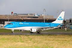 Embraer ERJ-175 from airline KLM lands on international airport. LANGENHAGEN / GERMANY - OCTOBER 28, 2017: Embraer ERJ-175 from airline KLM lands on Royalty Free Stock Photo