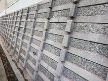 Langer Steinzaun/Wand stockbilder