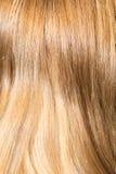 Langes blondes Haar als Hintergrund Lizenzfreie Stockbilder