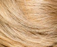 Langes blondes Haar als Hintergrund Lizenzfreies Stockfoto