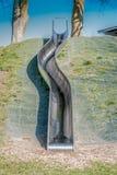 Langes Metalldia auf Spielplatz Lizenzfreie Stockbilder
