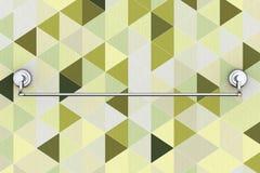 Langes neues Edelstahl-Tuch-Halter-Gestell auf einer abstrakten Olive Lizenzfreies Stockbild