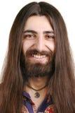 Langhaariger lächelnder Hippiemann stockfotografie