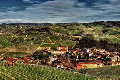 Langhe - View of the town of Barolo and its vineyards. The town of Barolo, with the Falletti castle, among the vineyards, in the center of the area of the stock photo
