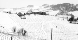 Langhe vineyards and village. Black and white photo. Winter panorama of the vineyards of Grinzane Cavour Piedmont, Northern Italy, UNESCO World Heritage Site royalty free stock image