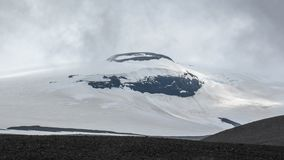 Langjokull glacier: white snow and black rock mountain. Contrasts of Icelandic Nature. West Iceland, Europe stock image