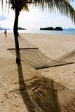 Langkawi island Malaysia deserted beach. Hammock swung stock photos