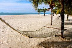 Langkawi island Malaysia deserted beach. Hammock swung Stock Photo