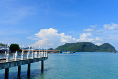 Langkawi islands. Scenic view of pier and blue sea with Langkawi islands in background, Malaysia Royalty Free Stock Images