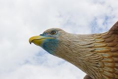 Head of big eagle statue on the sky background royalty free stock photography