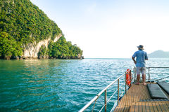 Langkawi, Malaysia. July 3, 2016: Enjoying the sunset cruise excursion that includes watching the sunset while having barbeque dinner on board the catamaran Stock Image