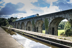Langollen Canal at Chirk Train Passes on Viaduct Royalty Free Stock Photo