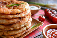 Langos with ketchup and cheese. stock photo