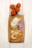 Langos ungheresi con la cipolla ed il bacon Immagini Stock