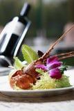 Langoustine et vin Image stock