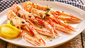Langoustine Shellfish on Platter with Lemon Slices Royalty Free Stock Images