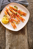 Langoustine Shellfish on Platter with Lemon Slices Royalty Free Stock Image