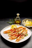 Langoustine Shellfish Served with Lemon and Oil Stock Images