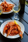 Langoustines in red bouzar sauce. Serbian cuisine. Vertical Royalty Free Stock Photography
