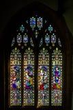 Langport彩色玻璃的E诸圣日教会 库存图片