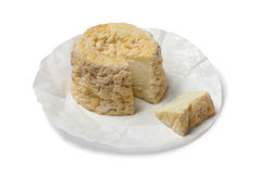 Langres cheese and portion Royalty Free Stock Photos