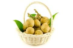 Langsat,Duku in basket royalty free stock photography