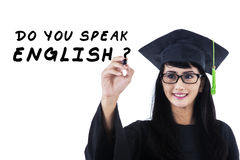 Language bachelor writes on whiteboard Royalty Free Stock Photo