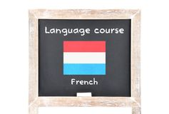 Language course with flag on board Stock Image