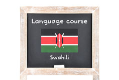 Language course with flag on board Royalty Free Stock Photography