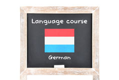 Language course with flag on board. Colorful and crisp image of language course with flag on board Stock Image