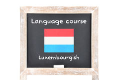 Language course with flag on board Royalty Free Stock Image