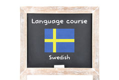 Language course with flag on board. Colorful and crisp image of language course with flag on board - Swedish Royalty Free Stock Images