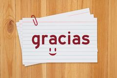Language flashcards with gracias message on white paper index cards