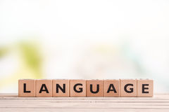 Language lesson sign on a table. Language lesson sign made of cubes on a table stock photo