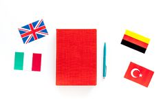 Language study concept. Textbooks or dictionaries of foreign language near flags on white backgrond top view. Language study concept. Textbooks or dictionaries Royalty Free Stock Image