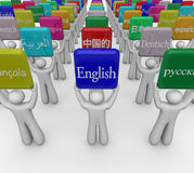 Languages Word Signs Held by People Translating Foreign Internat. International or foreign languages on signs held by people sharing culture and translating Royalty Free Stock Photo