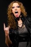 Langue et signe des klaxons Photo stock